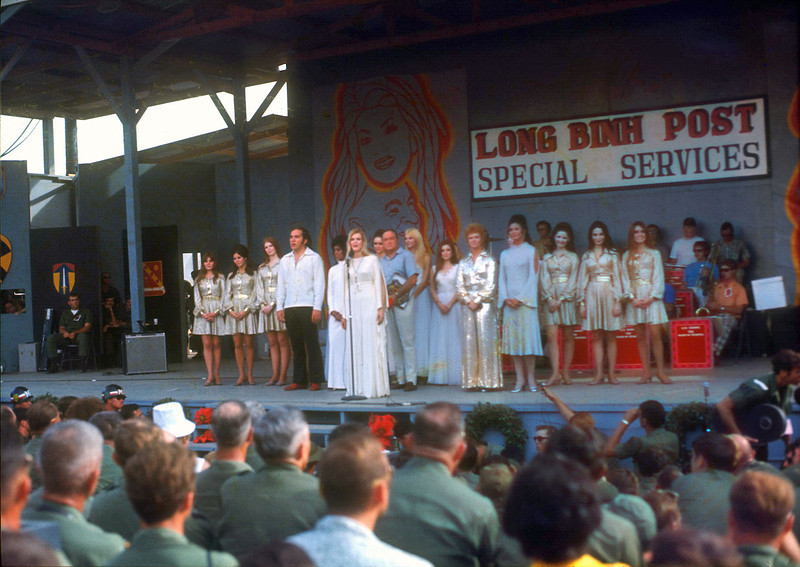 "Gloria Loring leads the cast and audience in ""Silent Night"" (12/25/70, Long Binh). © 1970, MJ Roche."