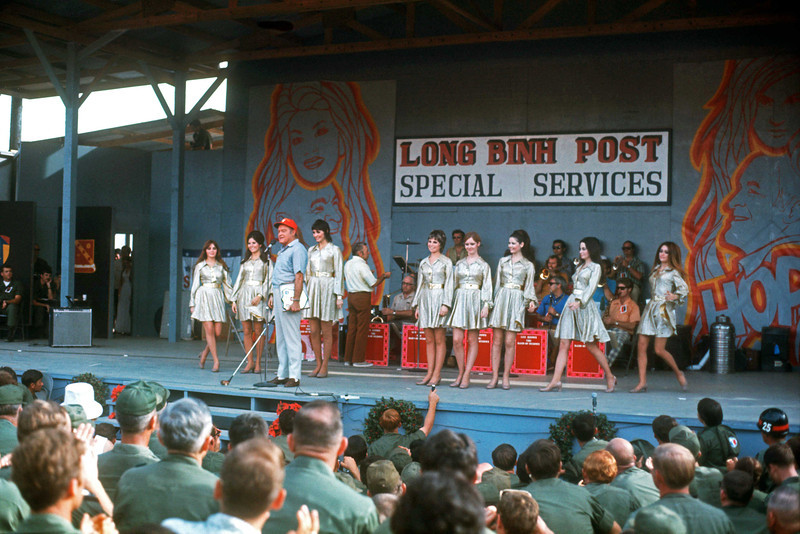"The ""Goldiggers"" from the Dean Martin Show take the stage at Long Binh behind Bob Hope (12/25/70). © 1970, MJ Roche."