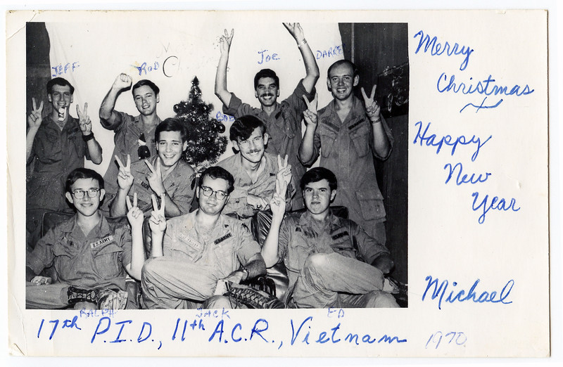 Homemade Christmas card mailed home, December, 1970. (17th Public Information Detachment, 11 Armored Cavalry Regiment, Di An, RVN). Bottom row left to right Ralph ..., Jack McAllister, Ed Yocum.  Middle row Mike Roche, Bob Eveler. Top row Jeff Lowe, Rod Covington, Joe Marchesani, Darrel Jensen.   <br /> Taken in the rec. area at the back of the 17th PID hooch, which combined our barracks and our office.  Processed in the 11th ACR Photo Lab Duece-and-a-Half at Di An by Ed Yocum. Photo by RJ House 28th Military History Detachment, Di An.