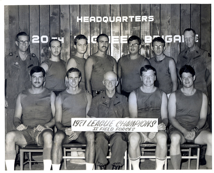 The winning team photo from a basketball league at Bien Hoa, Vietnam, March, 1971.  Brigadier General Kenneth B. Cooper poses with NCOs and enlisted men including Albert Gore, Jr., (lower right).  Photo by SP5 H. Alan Leo, US Army Engineers.