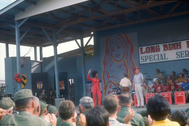 Lola Falana takes the stage at Long Binh, amid a torrent of cheers! © 1970, MJ Roche.