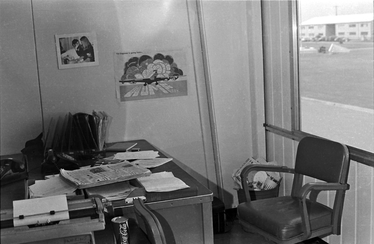 "Author's desk at the newspaper office at Long Binh. Note the Coke can opened by a ""church key"" in pre-pop-top  days."
