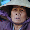 "A local Vietnamese women wearing a conical hat at the centrally located market - Dalat, Vietnam.  This is a travel photo from Da Lat, Vietnam. <a href=""http://nomadicsamuel.com"">http://nomadicsamuel.com</a>"