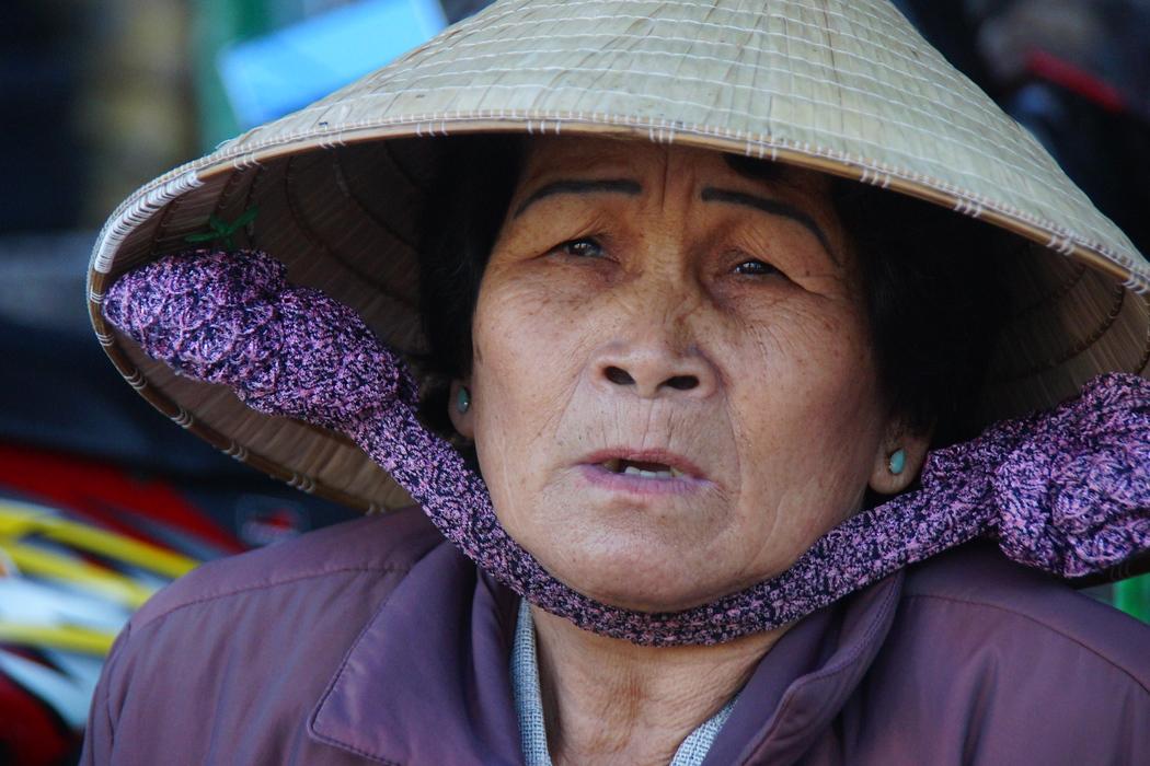 Lady wearing conical hat in Dalat, Vietnam