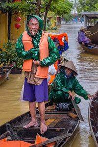 Boatman offers rides in flooded Hoi An, Viet Nam