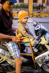 Families on Motorbikes in Hoi An, Viet Nam