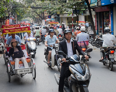 Motorbikes are the primary mode of transportation in Hanoi, Viet Nam