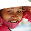 "A Vietnamese lady wearing a conical hat radiates a beautiful smile - Mekong Delta, Vietnam. <a href=""http://nomadicsamuel.com"">http://nomadicsamuel.com</a>"