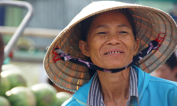 Vietnamese lady wearing conical hat