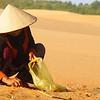 "A lady collecting garbage in the sand dunes - Mui Ne, Vietnam. <a href=""http://nomadicsamuel.com"">http://nomadicsamuel.com</a>"