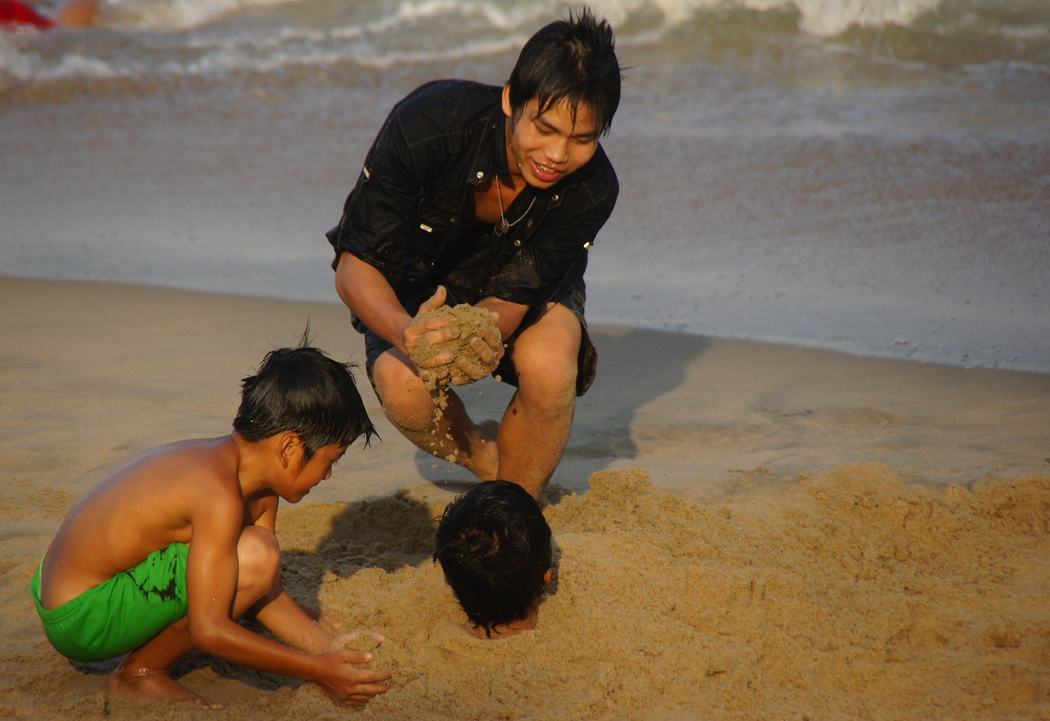 Playing with sand at the beach in Nha Trang, Vietnam