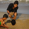 "Local Vietnamese boys having fun playing & burying one another in the sand on the beach - Nha Trang, Vietnam.  This is a travel photo from Nha Trang, Vietnam.  To purchase this photo click on it or to view the rest of my gallery from Nha Trang, Vietnam click here. <a href=""http://nomadicsamuel.com"">http://nomadicsamuel.com</a>"