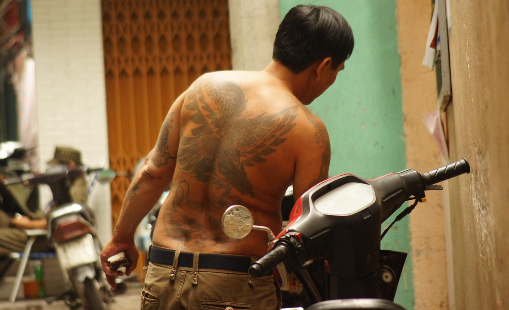 A Vietnamese man with many elaborate tattoos on his back - Saigon, Vietnam.  Travel photo from Ho Chi Minh City, Vietnam.