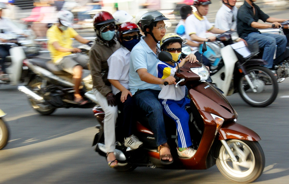 A family of four on a moped in Saigon, Vietnam