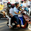 Today's daily travel photo is of a Vietnamese family of four on a scooter whizzing through an intersection in the ever hectic Ho Chi Minh City (Saigon), Vietnam.
