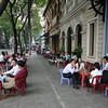 typical sidewalk cafe. Notice how small the plastic chairs are!