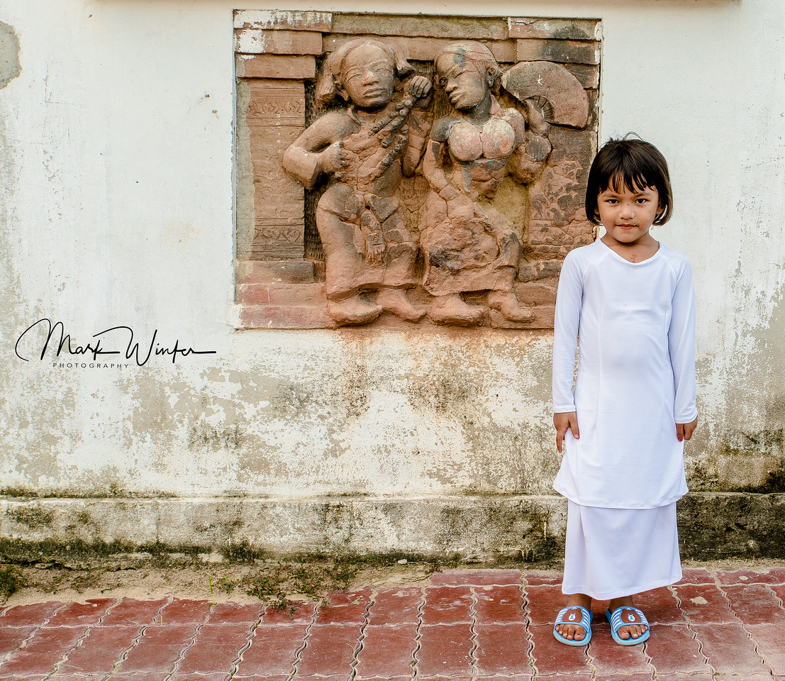 Young Cham girl poses for a photo, Phan Thiet