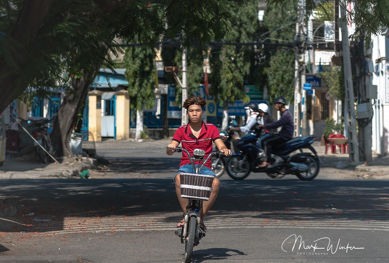 Boy Riding Bicycle in Phan Rang