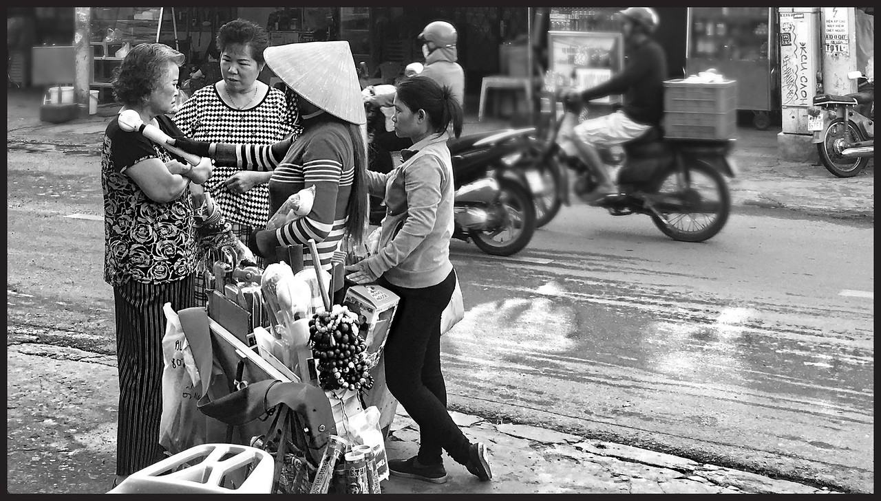 Saigon, selling a back massager