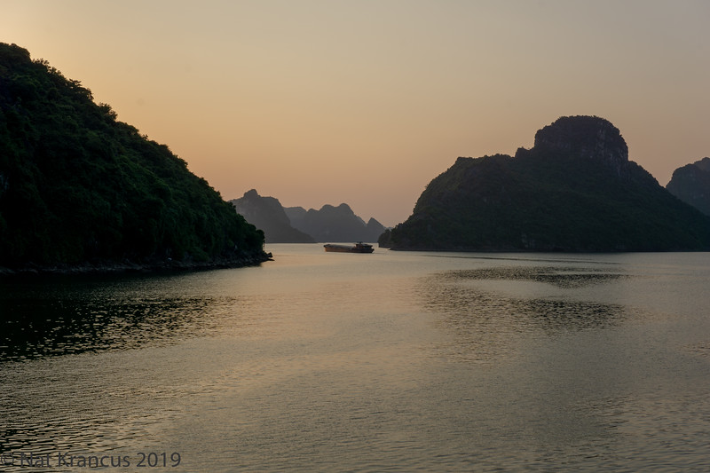 Freighter in Hạ Long Bay at Sunset