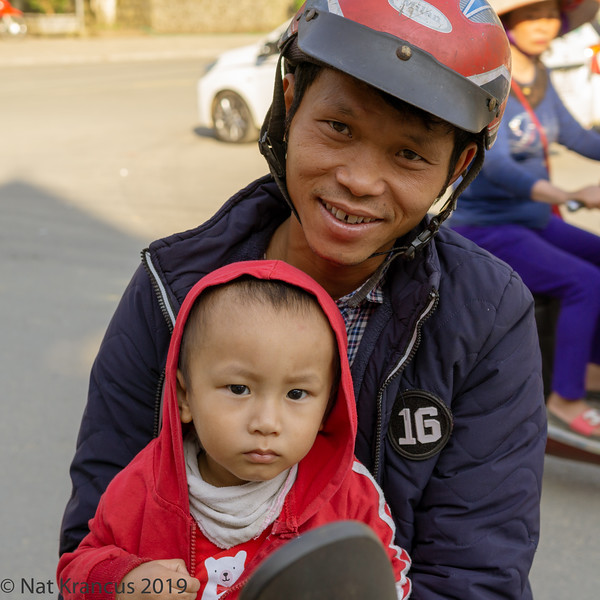 Man and His Son on a Motorcycle in Bac Ha