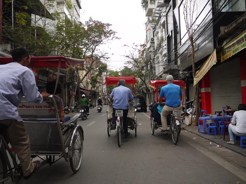 PEter rides cyclo -- at right