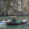 Officials question floating market boat.  Halong Bay.