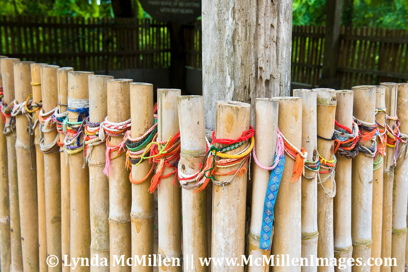 Memorial Prayer bracelets left on the fences marking the mass graves in the Khmer Rouge Killing Fields.