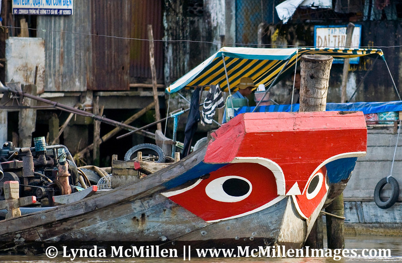 """Eyes"" placed on the bow of merchant boats were believed to scare off large fish, crocs and other beasts that could damage boat or threaten its cargo.   Fishing boats do not have ""eyes"" painted on their bows."