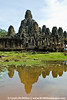 "Bayon Temple, the center of Angkor Thom, reflected in seasonal ""puddle""."