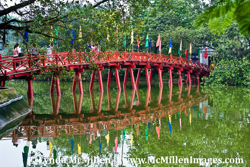 Huc Bridge leads to Den Ngoc Son, the Temple of the Jade Mound, founded in 14th century.