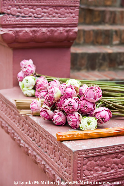 Flowers left to honor former king at shrine in Wat Phnom Park.