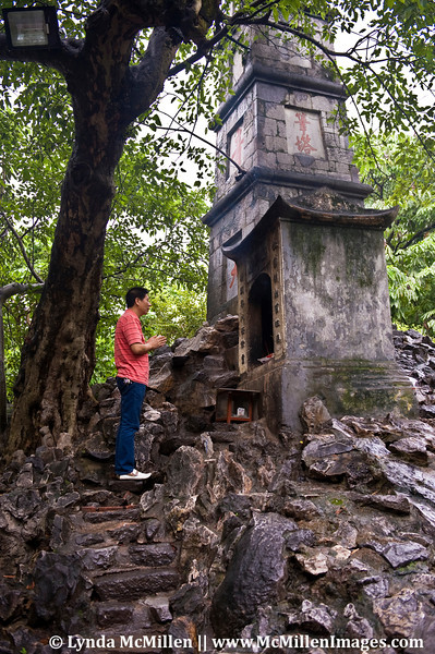 Praying at one of the alters at Den Ngoc Son.
