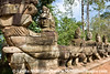 """South entrance to Angkor Thom (""""Big City"""") built by Khmer King ~1000 years ago.  The Angkor Archaeological Park is a UNESCO World Heritage Site.  Some of the statues lining the south causeway to Angkor Thom still have their original conical hats.  Others have been restored to show their initial grandeur."""