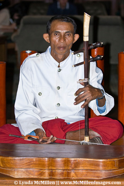 Tro player.  An ancient and traditional bowed string instrument in Cambodia.