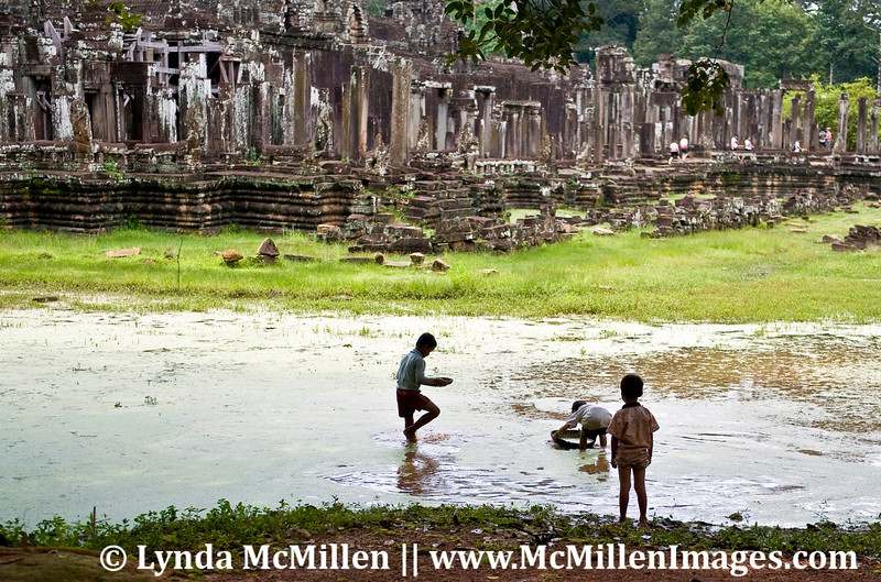 Locals playing in a moat at Angkor Thom.