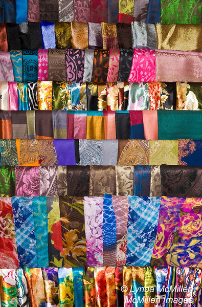 Colorful silk scarves displayed at store in the French Quarter, Hanoi, Vietnam.
