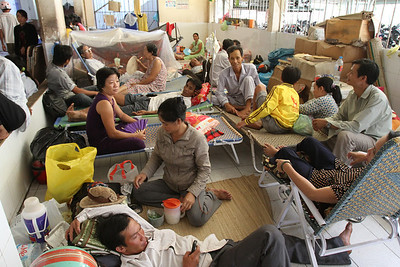 Families camped out wherever they could find space in a hospital in Rach Gia, southern Vietnam