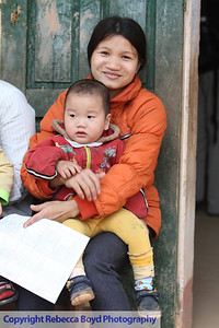 A child and mother are next in line for checkups during a medical  mission to Vietnam
