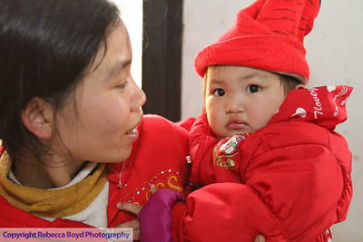 Mother with her child returned for a second surgery to repair the child's cleft palate  during a medical mission to Vietnam