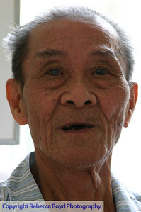 An elderly man waits for cataract surgery during a medical mission to Vietnam