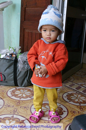 A child in an orphanage observes the western doctors and nurses doing physical exams during a medical mission to Vietnam