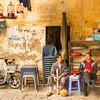 Two Hanoi Gentlemen and Five Bird Cages