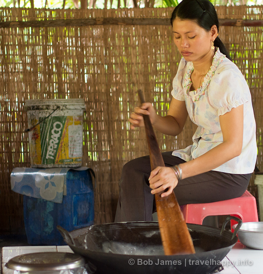 Electric stoves have replaced open flame hearths at Ben Tre's coconut candy shops