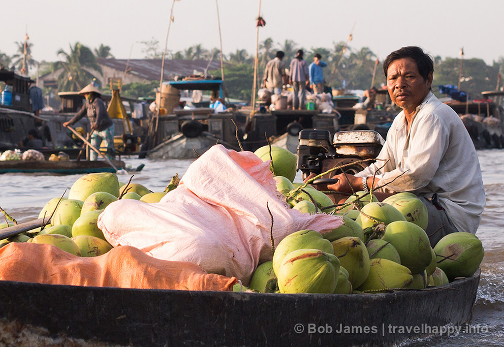 A melon vendor looks for customers at Can Tho's floating market