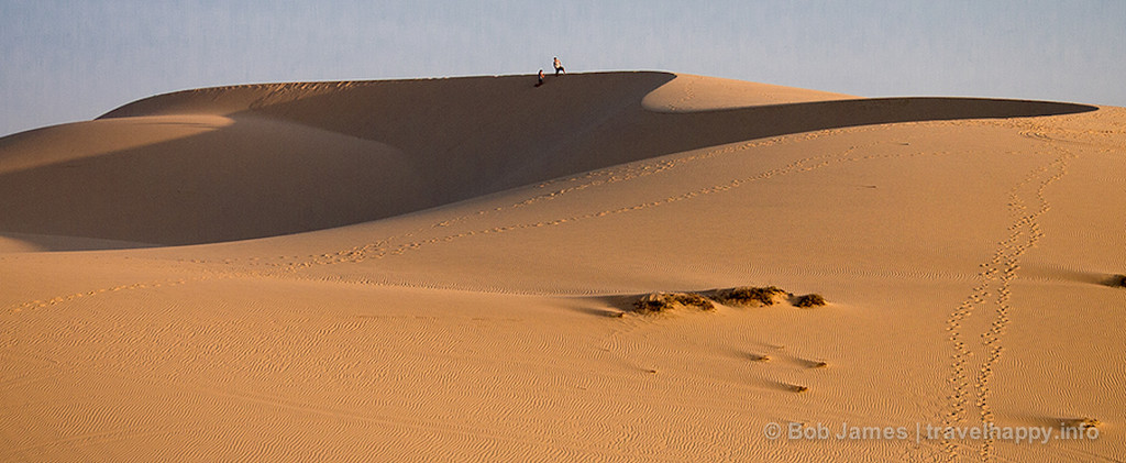 """See that black dot at the top of that dune? It's a person."""