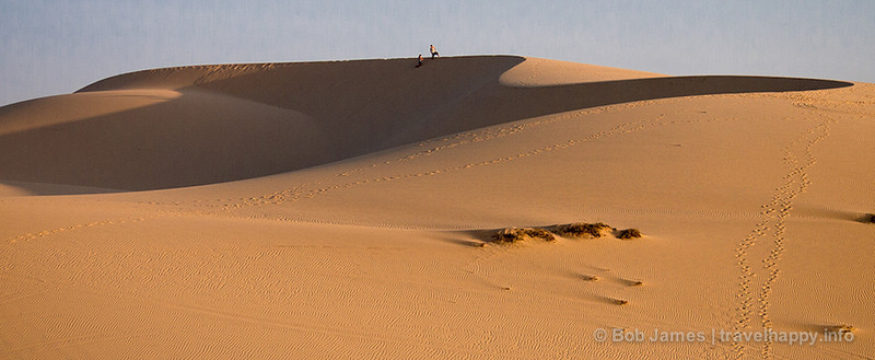 """""""See that black dot at the top of that dune? It's a person."""""""