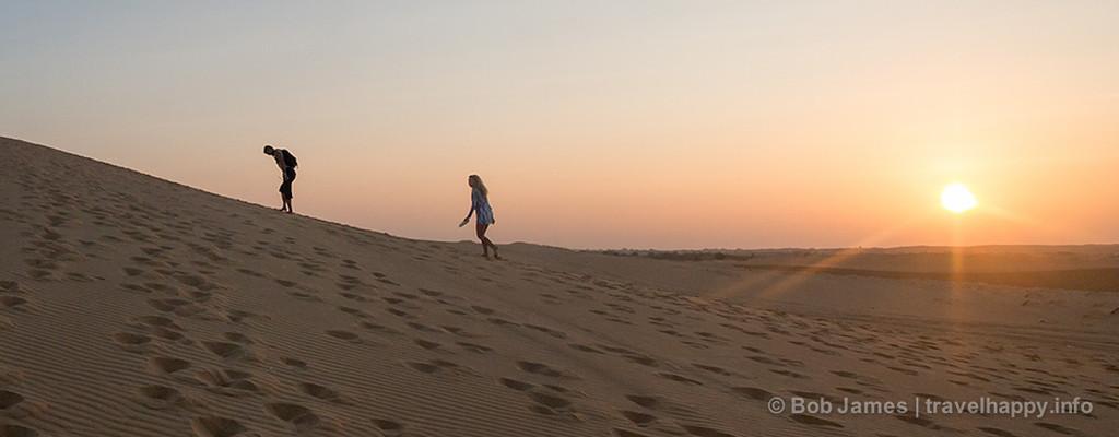 Sunrise is the best time to explore the white-sand dunes near Mui Ne, Vietnam.