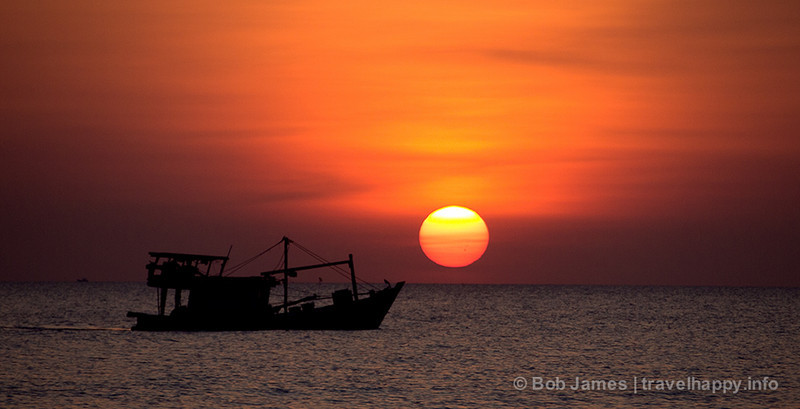 A fishing boat circles for a last catch at sunset off Phu Quoc.