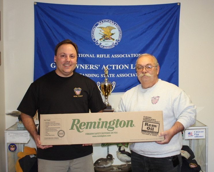 Owen (Mickey) Emery is shown here picking up a Remington 870 Shotgun from<br /> Jon Green of GOAL( Gun Owners Action League) Director of Education and<br /> Mike's Gun Shop. Jon in showing support for our Disabled Veterans has<br /> wavered the transfer fees on all the Rifles and pistols that DVSS (Disabled<br /> Veterans Shooting Sports) has acquired from various gun Co.<br /> <br /> REMINGTON along with Companies such as RUGER,HENRY,KAHR ARMS and many others<br /> in showing there support to our Nations Disabled Veterans have given DVSS<br /> great prices on there rifles, and pistols and equipment so that the veterans<br /> can enjoy the time they spend at the range, in some cases they donate<br /> products. Mickey is a Vietnam Veteran (67-68),is Vice President State Council and member<br /> of Chapter 818 RI.<br /> <br /> He started having events over five years ago and three years ago added the<br /> Shooting Range with the help of the Bellingham Police Dept. Two years ago he<br /> established (Disabled Veterans Shooting Sports) with one of his closes<br /> friends Dennis Auger also a Vietnam Veteran (67-68). Mick is founder and<br /> President and Dennis is the Vice President.<br /> <br /> The Co. has NO paid employee's it is all volunteer, and every cent go to the<br /> Disabled Veteran events they depended on donations and function to purchase<br /> the equipment for these veterans to enjoy a day of Fishing or range<br /> shooting.<br /> <br /> At present Mickey has been working with a group called HAVA(Honored American<br /> Veterans Afield) a Non-Profit Company that does the same kind of work, but<br /> on a larger scale.  honoredveterans.org.<br /> <br /> If you would like to help or donate please call Mick at 1-508-966-9024 or<br /> e-mail him at mickey2910@comcast.net